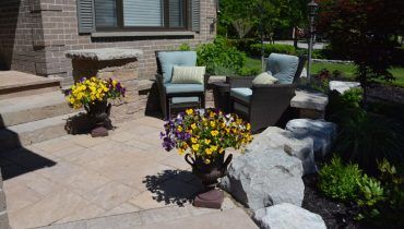 Interlocking Stone Front Patio with Armour Stone Border