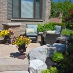 Interlocking Stone Front Patio with Armor Stone Retaining Wall